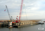 12.13.2006 The contractor is unloading concrete piles at the barge access area on Garretts Channel