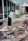 June 23rd, 1962 Maurice Shaw, Sr Shovels Out Sand From Under 5128 Central Ave To Access Water Pipes